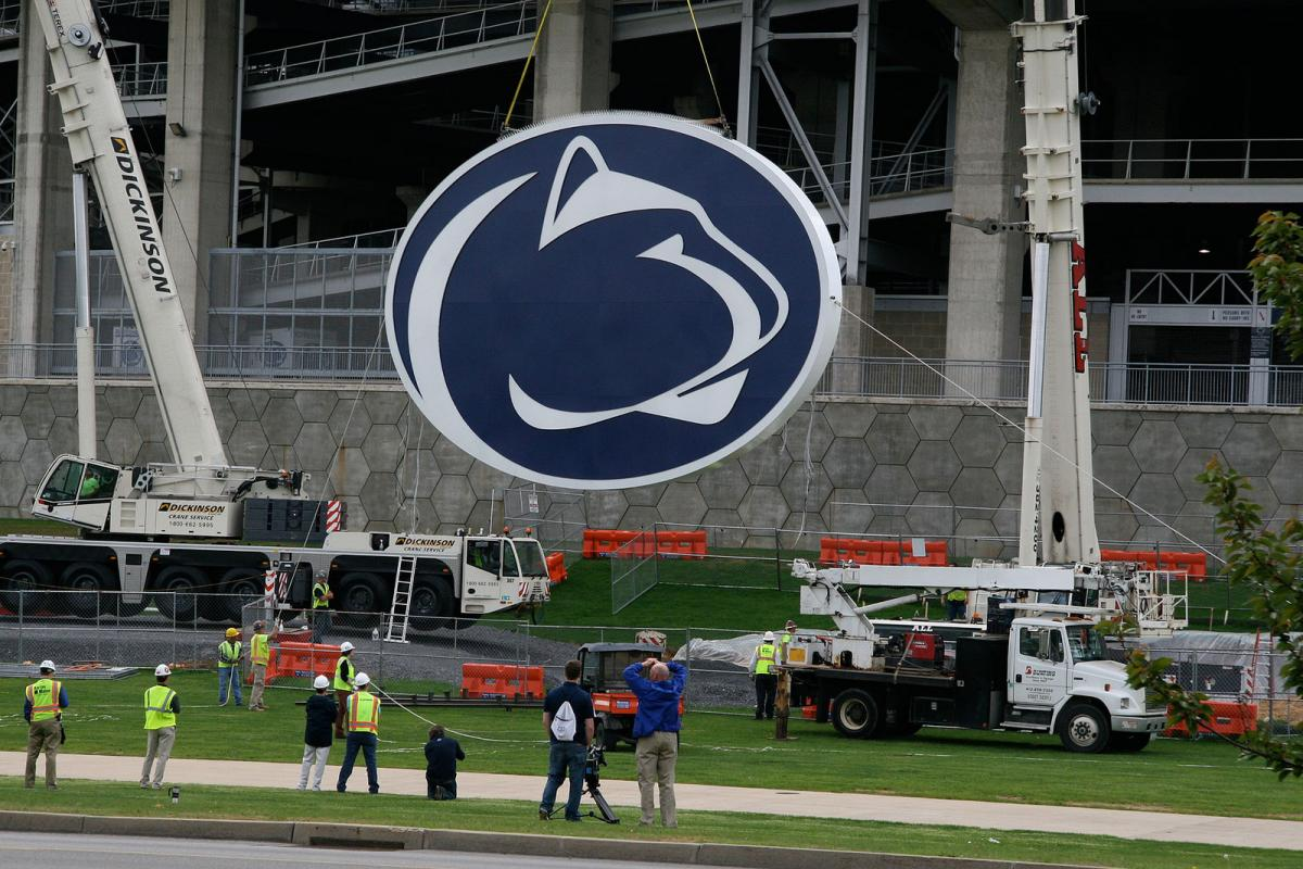 Crane lifting Penn State Logo for Beaver Stadium